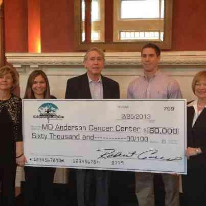 Andy's Family Presents a Check to M.D. Anderson Cancer Center in 2013
